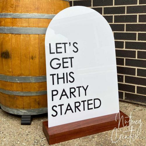 $60 Hire<br>Acrylic Arched Sign with wooden stand <br>'Let's get this party started'<br>